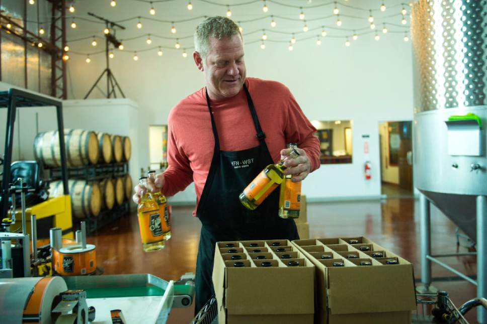 Chris Detrick  |  The Salt Lake Tribune Cider maker Joel Goodwillie labels bottles of 7 Mile Session Hard Cider at Mountain West Hard Cider on Wednesday, March 22, 2017.