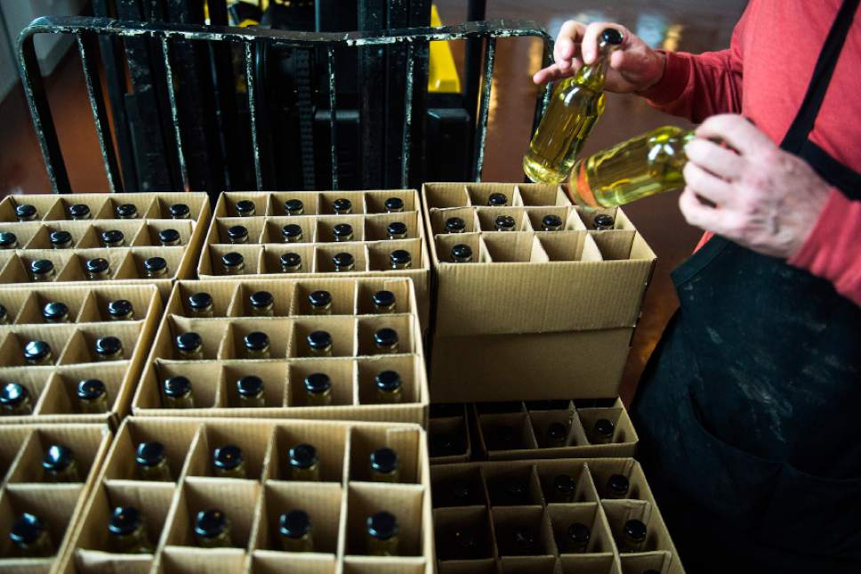 Chris Detrick  |  The Salt Lake Tribune Cider maker Joel Goodwillie labels bottles of 7 Mile Session Hard Cider at Mountain West Hard Cider on Wednesday March 22, 2017.