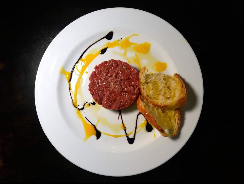 Scott Sommerdorf | The Salt Lake Tribune Steak tartare and bruschetta appetizer at Veneto in Salt Lake City.