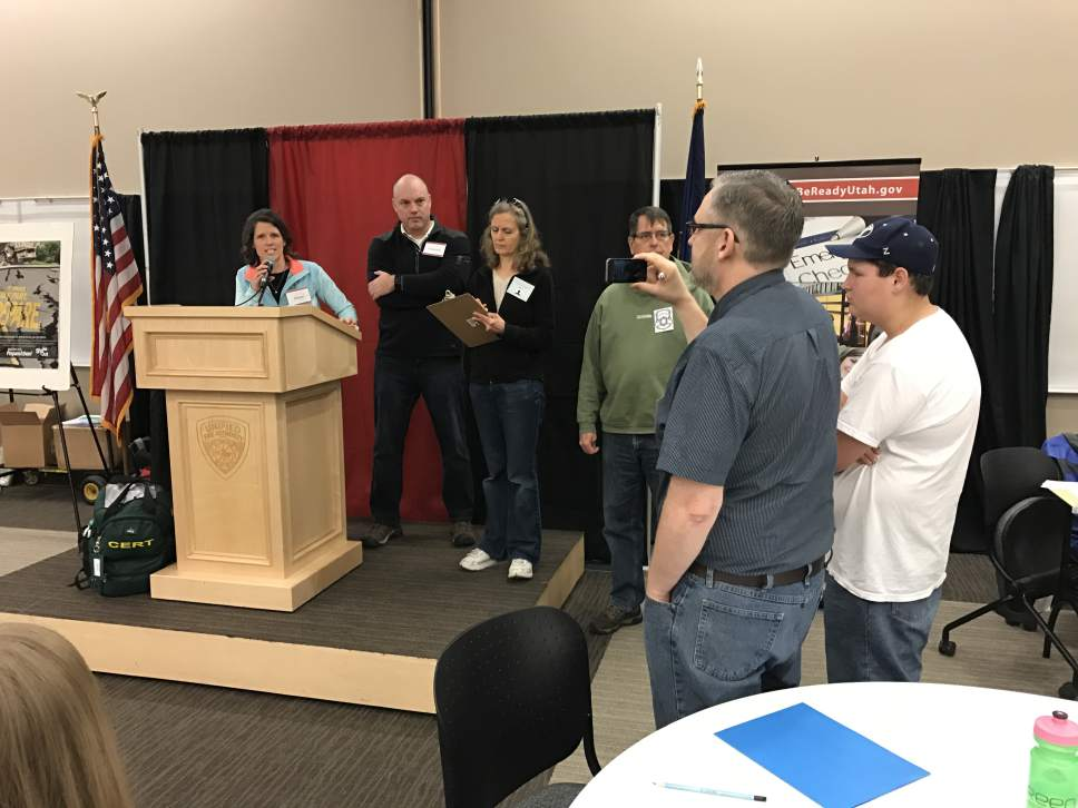 Benjamin Wood     Salt Lake Tribune Teresa Reese, of Sandy, and Mike Weist, of Herriman, hold a mock press conference as mayor and governor during a community disaster simulation in Herriman on Saturday, March 25.