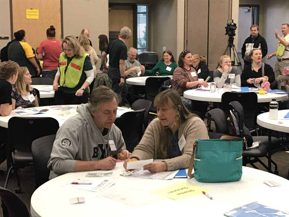 Benjamin Wood     The Salt Lake Tribune Roland and Renee Schiffler take part in a community disaster simulation in Herriman on Saturday.