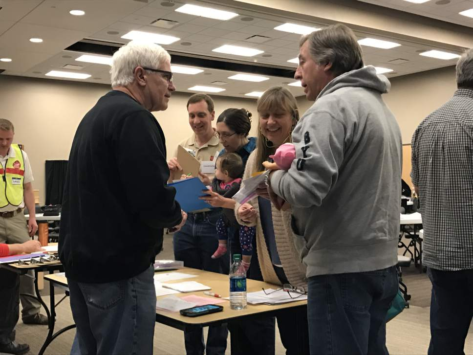 Benjamin Wood     The Salt Lake Tribune Roland and Renee Schiffler check in at a mock health clinic during a community disaster simulation in Herriman.