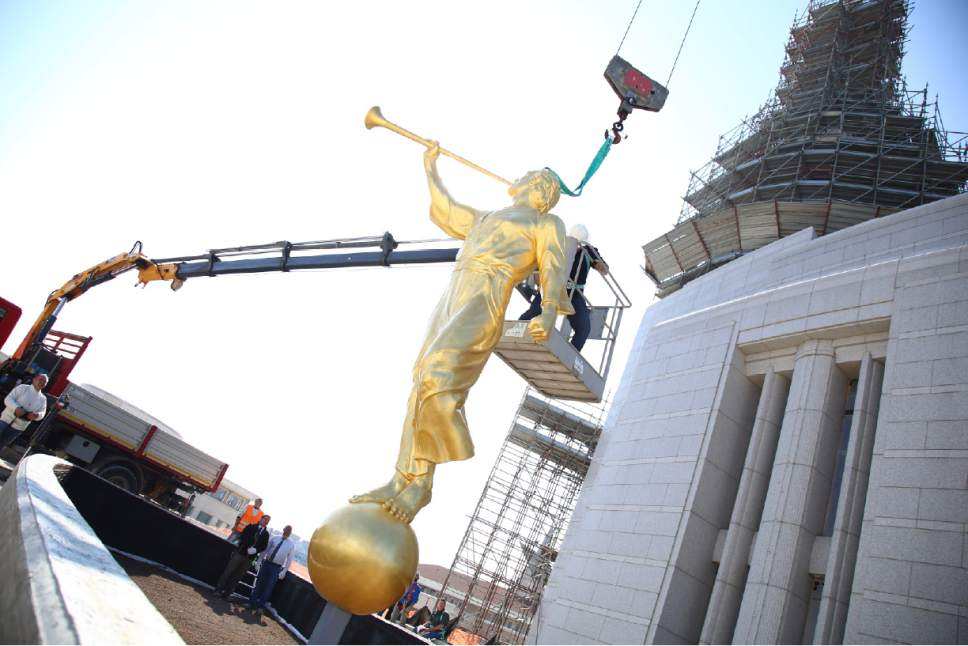 The angel Moroni statue begins its ascent to be placed on the top of the Rome Italy Temple March 25, 2017. Courtesy Photo | Intellectual Reserve, Inc.