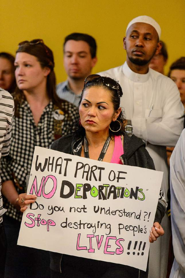 Trent Nelson  |  The Salt Lake Tribune Alicia Cervantes holds a sign against deportations at a news conference where religious and community leaders gathered at the Madina Masjid Islamic Center in Salt Lake City to show support, Friday March 10, 2017.