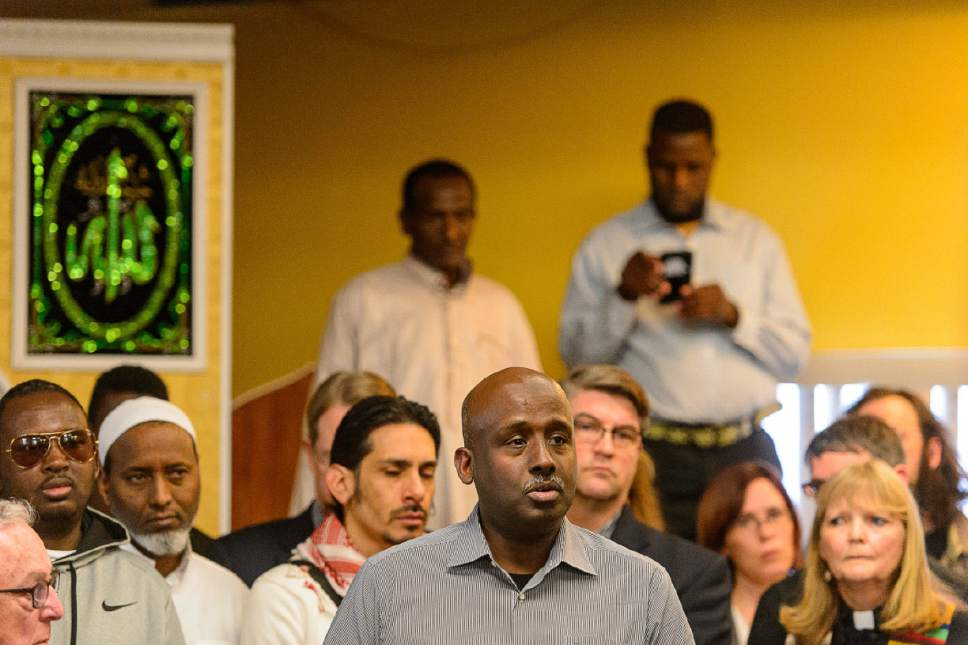 Trent Nelson  |  The Salt Lake Tribune Aden Batar, Immigration and Refugee Resettlement Director at Catholic Community Services, speaks at a news conference where religious and community leaders gathered at the Madina Masjid Islamic Center in Salt Lake City to show support, Friday March 10, 2017.