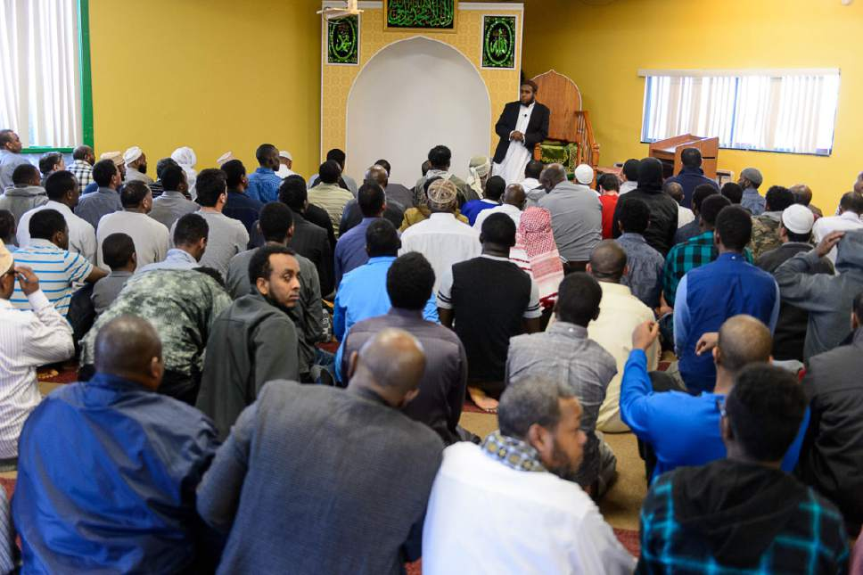 Trent Nelson  |  The Salt Lake Tribune Imam Yussuf Abdi speaks to men gathered for Friday prayers at Madina Masjid Islamic Center in Salt Lake City, Friday March 10, 2017. Religious and community leaders gathered at the center in support of their Muslim Brothers and Sisters, regarding ICE activities and the detention of a Kenyan couple.