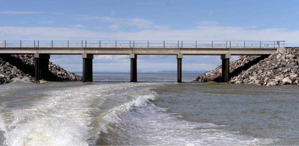 Al Hartmann  |  The Salt Lake Tribune Water flows around the new, wider breach in the causeway that separates the north and south arms of the Great Salt Lake.