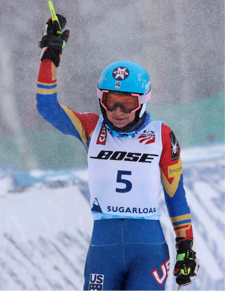 Megan McJames, of Park City, Utah, raises her pole while celebrating after her second run at the women's giant slalom skiing race at the U.S. Alpine Ski Championships at Sugarloaf Mountain Resort in Carrabassett Valley, Maine, Monday, March 27, 2017. McJames won the race. (AP Photo/Charles Krupa)