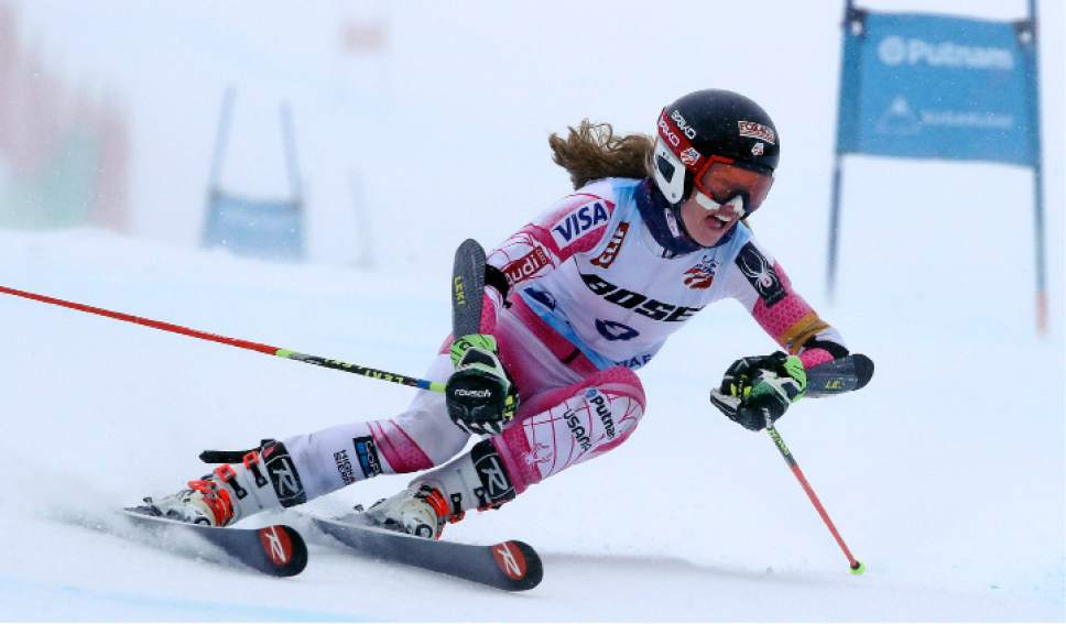Patricia Mangan, of Derby, N.Y., carves a turn on her first run at the women's giant slalom skiing race at the U.S. Alpine Ski Championships at Sugarloaf Mountain Resort in Carrabassett Valley, Maine, Monday, March 27, 2017. Mangan finished third. (AP Photo/Charles Krupa)