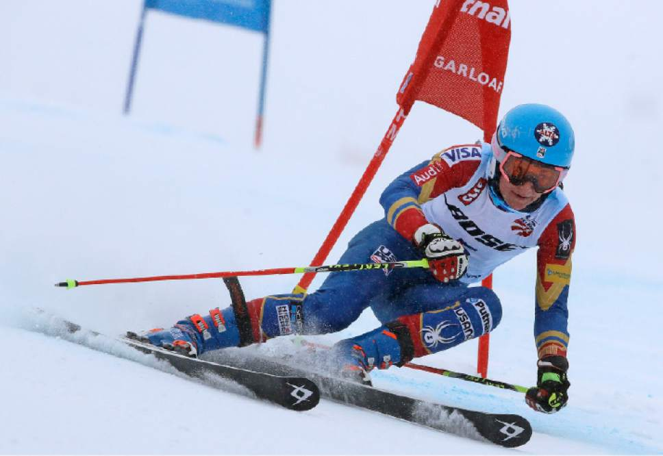 Megan McJames, of Park City, Utah, carves a turn on her first run at the women's giant slalom skiing race at the U.S. Alpine Ski Championships at Sugarloaf Mountain Resort in Carrabassett Valley, Maine, Monday, March 27, 2017. McJames won the race. (AP Photo/Charles Krupa)