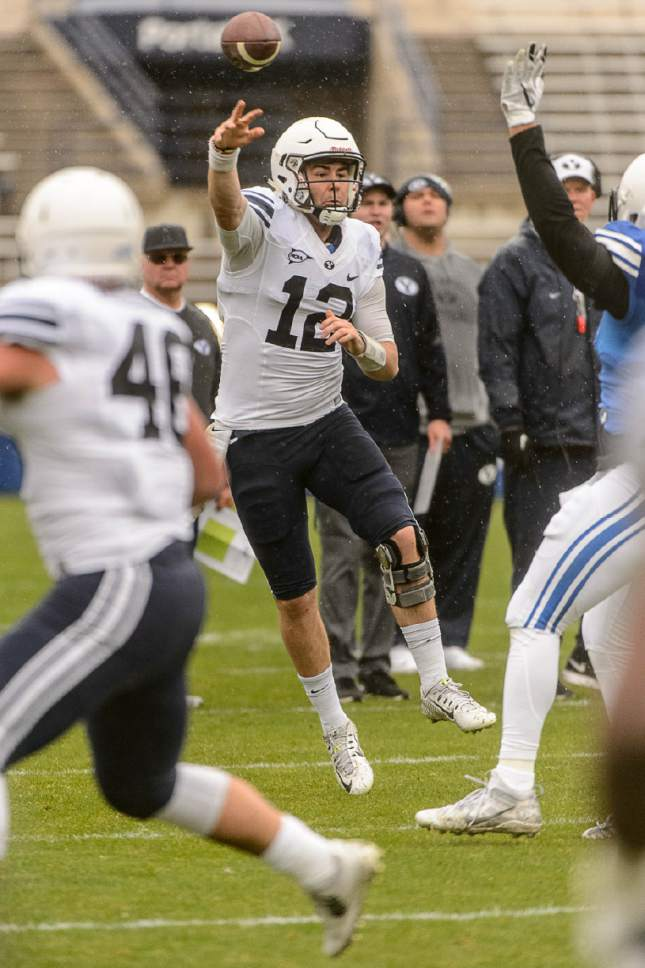 Trent Nelson  |  The Salt Lake Tribune BYU quarterback Tanner Mangum passes the ball during the annual spring football scrimmage in Provo, Saturday March 25, 2017.