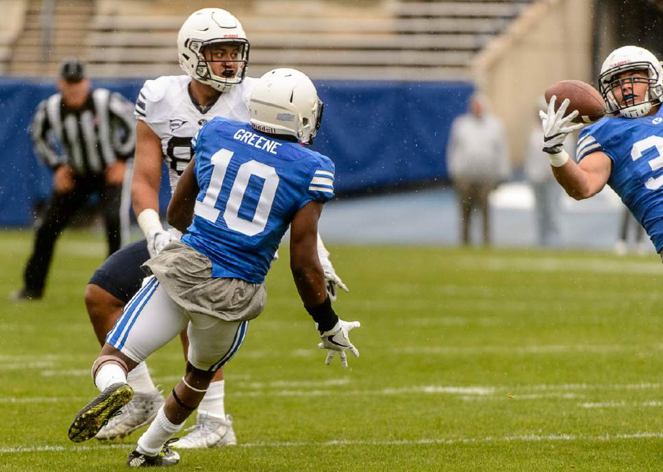 Trent Nelson  |  The Salt Lake Tribune BYU's Butch Pau'u pulls in an interception, the ball intended for Joe Takuafu (at left), during the annual spring football scrimmage in Provo, Saturday March 25, 2017.