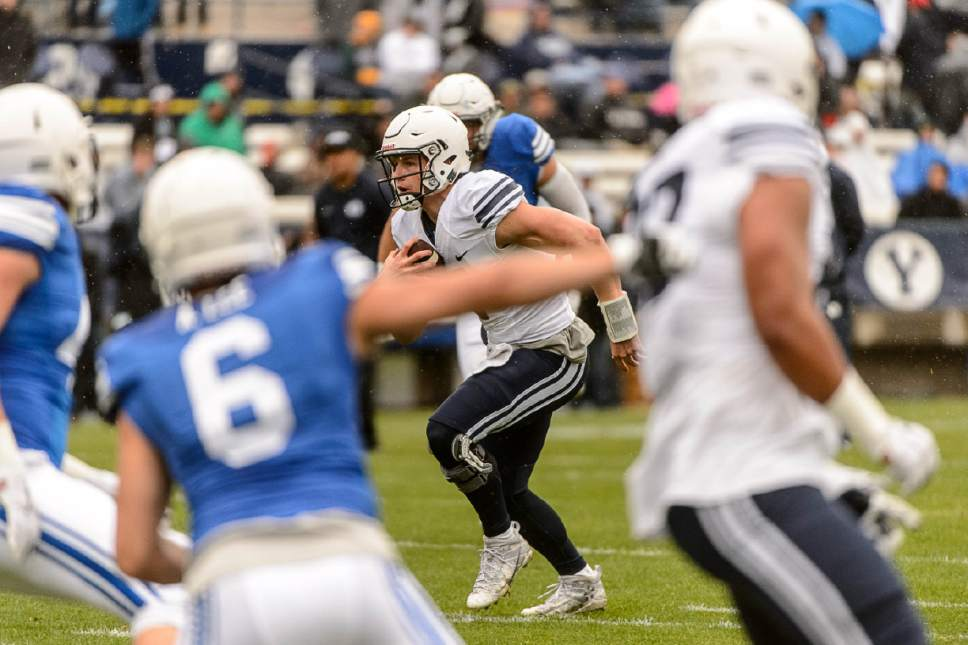 Trent Nelson  |  The Salt Lake Tribune BYU quarterback Beau Hoge runs during the annual spring football scrimmage in Provo, Saturday March 25, 2017.