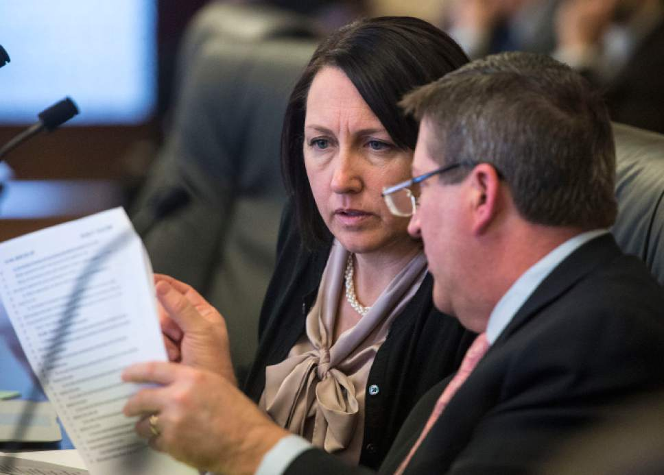 Steve Griffin  |  The Salt Lake Tribune   Rep. Karianne Lisonbee, R-Clearfield, and Rep.Tim Quinn, R-Heber discuss HB452 during the House Revenue and Taxation Standing Committee the State Capitol in Salt Lake City Monday March 6, 2017. HB452 Homeless Services Amendments modifies provisions related to sales and use taxes and the provision of services to the homeless.