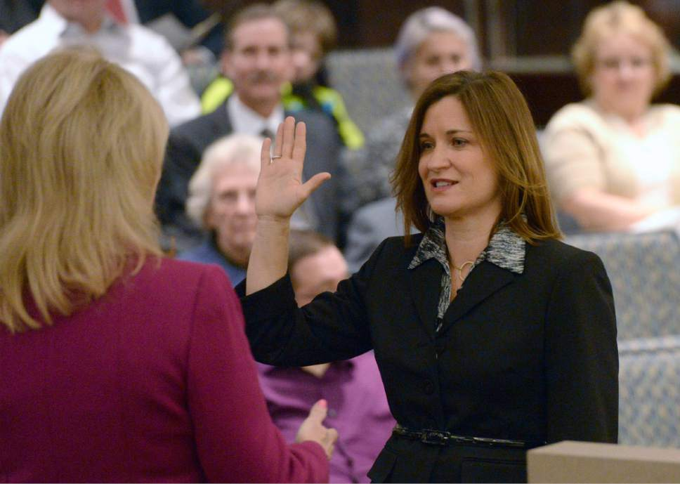 Al Hartmann  |  Tribune file photo Salt Lake County Councilwoman Jenny Wilson takes the oath of office for her second six-year term in the Salt Lake County Council chamber,  Monday Jan. 5, 2015.