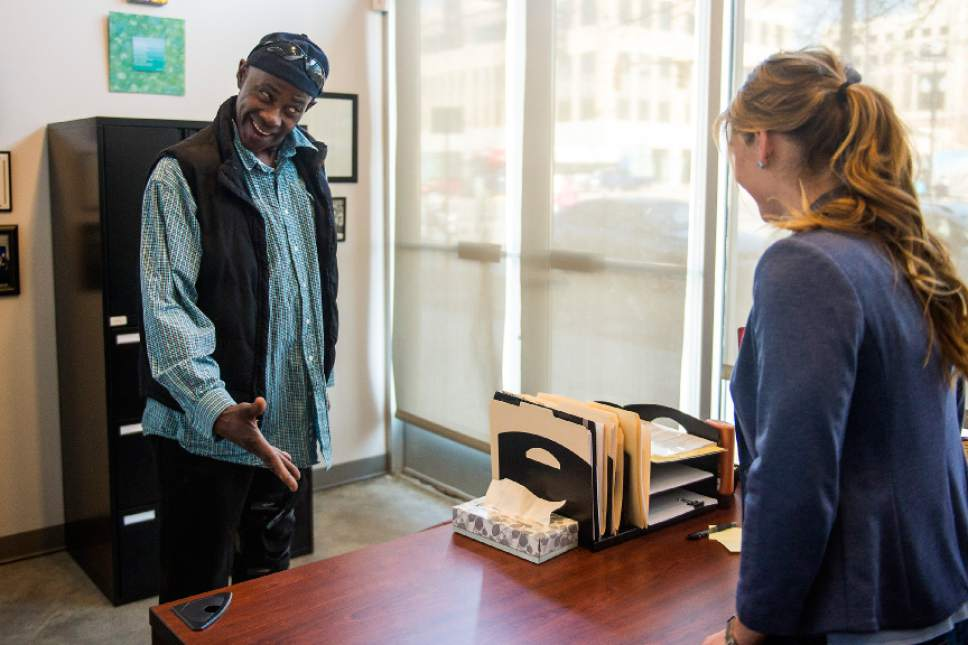 Chris Detrick  |  The Salt Lake Tribune Social work Manager Lana Dalton talks with Rodney (no last name given) at the Community Connection Center in Salt Lake City Tuesday February 14, 2017.