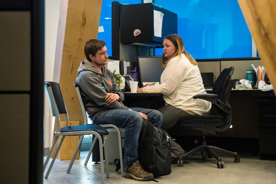 Chris Detrick  |  The Salt Lake Tribune Case Manager Debbie Davis talks with Eric Bird at the Community Connection Center in Salt Lake City Tuesday February 14, 2017.