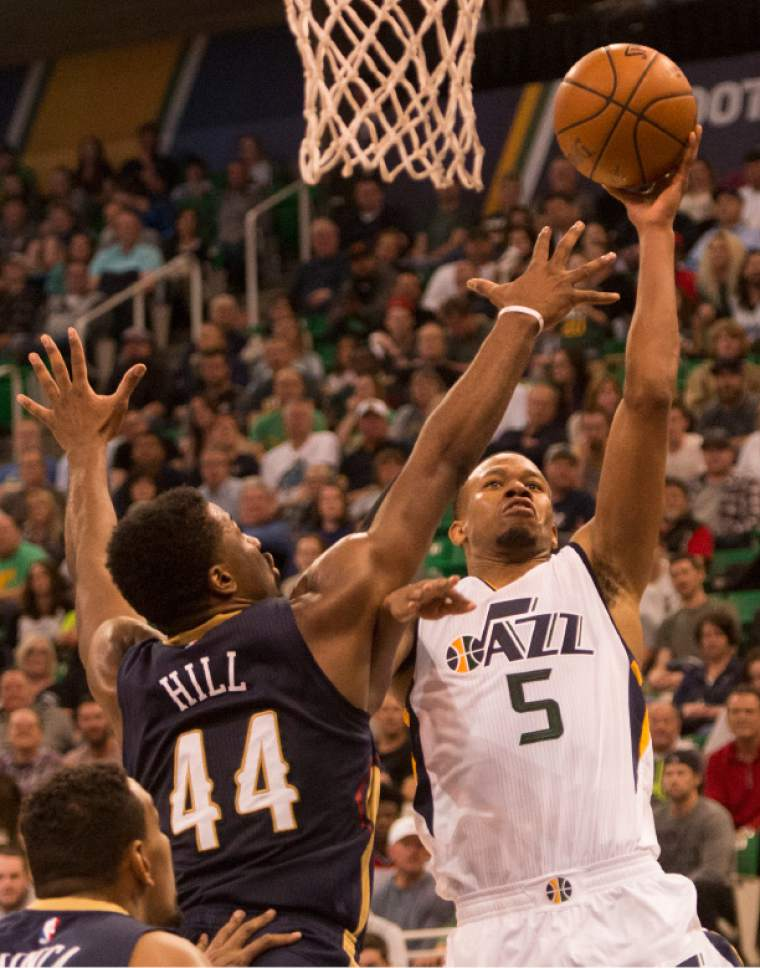 Rick Egan  |  The Salt Lake Tribune  Utah Jazz guard Rodney Hood (5) goes up for a shot  as New Orleans Pelicans forward Solomon Hill (44) defends, in NBA action Utah Jazz vs. New Orleans Pelicans, in Salt Lake City, Monday, March 27, 2017.