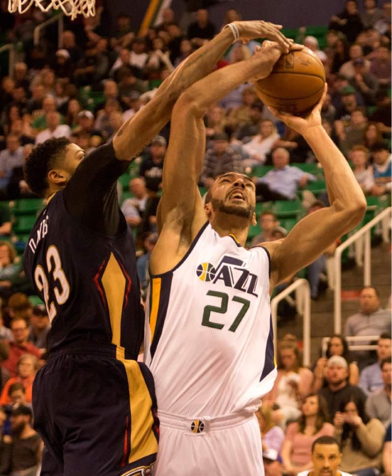 Rick Egan  |  The Salt Lake Tribune  Utah Jazz center Rudy Gobert (27) shoots as New Orleans Pelicans forward Anthony Davis (23) defends, in NBA action Utah Jazz vs. New Orleans Pelicans, in Salt Lake City, Monday, March 27, 2017.