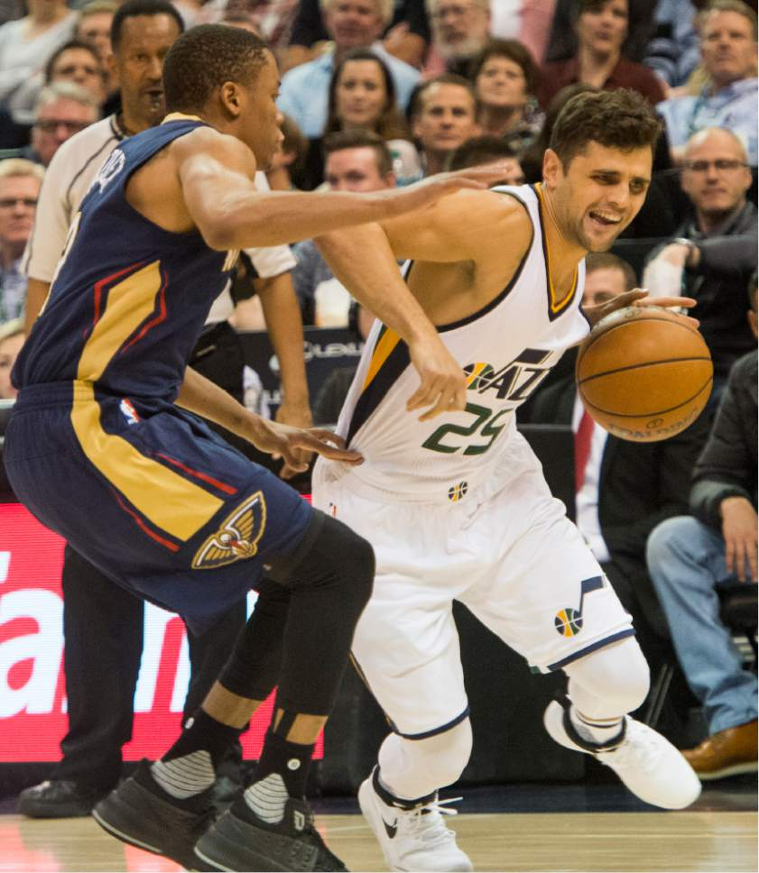 Rick Egan  |  The Salt Lake Tribune  Utah Jazz guard Raul Neto (25) takes the ball inside, as New Orleans Pelicans guard Tim Frazier (2) defends, in NBA action Utah Jazz vs. New Orleans Pelicans, in Salt Lake City, Monday, March 27, 2017.