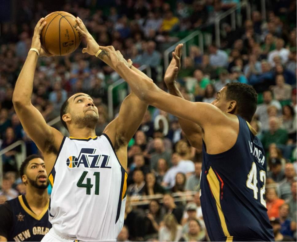 Rick Egan  |  The Salt Lake Tribune  Utah Jazz forward Trey Lyles (41) goes to the hoop, as New Orleans Pelicans center Alexis Ajinca (42) defends, in NBA action Utah Jazz vs. New Orleans Pelicans, in Salt Lake City, Monday, March 27, 2017.