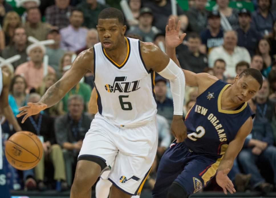 Rick Egan  |  The Salt Lake Tribune  Utah Jazz forward Joe Johnson (6) gets past New Orleans Pelicans guard Tim Frazier (2), in NBA action Utah Jazz vs. New Orleans Pelicans, in Salt Lake City, Monday, March 27, 2017.