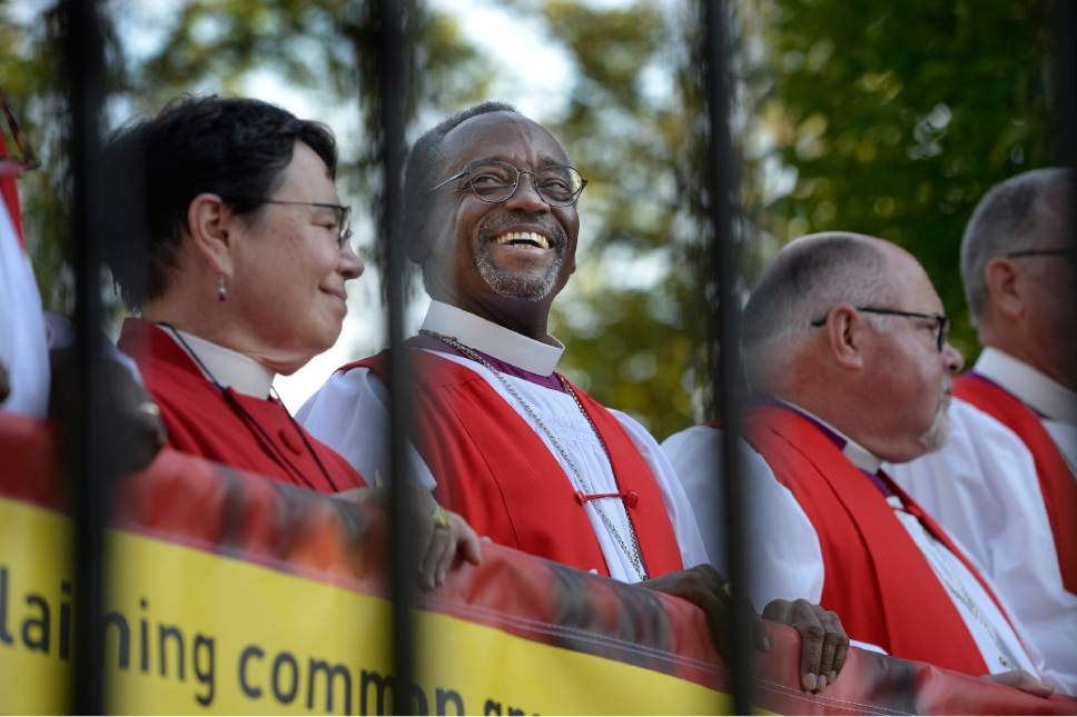 Scott Sommerdorf   |  The Salt Lake Tribune Bishop Michael Curry of North Carolina, center, who was elected at the 27th Presiding Bishop of the Episcopal Church reacts during another speaker's comments after a march against gun violence held in Salt Lake City, Sunday, June 28, 2015.