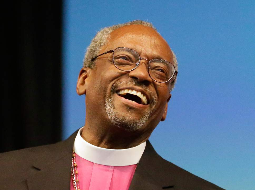 FILE - In this Saturday, June 27, 2015 file photo, Bishop Michael Curry of North Carolina, smiles after being elected the Episcopal Church's first African-American presiding bishop at the Episcopal General Convention in Salt Lake City. Curry won the vote in a landslide. His installation ceremony is scheduled for Sunday, Nov. 1, 2015. (AP Photo/Rick Bowmer)