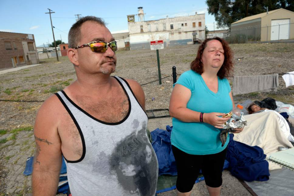 """Al Hartmann     The Salt Lake Tribune Lynn Jordan and friend """"Marge"""" have been camping out on a strip of ground between the city sidewalk and a field marked """"No tresspassing"""" at about 500 W. and 350 S.  He is among a new group of homeless who are camping out on the 500 West Commons just west of the Rio Grande Depot and a block or two south of the shelter."""