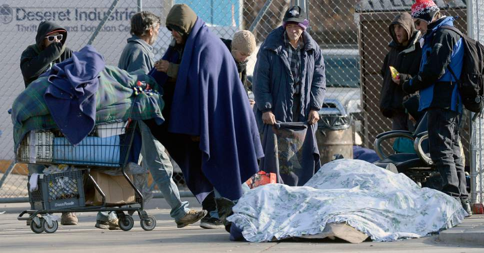 Al Hartmann     The Salt Lake Tribune Bundled up homeless people in blankets and winter clothing either hunker down in place or keep walking to stay warm along 500 West near the Road Home shelter on a cold morning Wedneday Dec. 7.   The Collective Impact steering committee met today to review a survey of homeless people in the Rio Grande area to determine if more overflow shelter space is needed.
