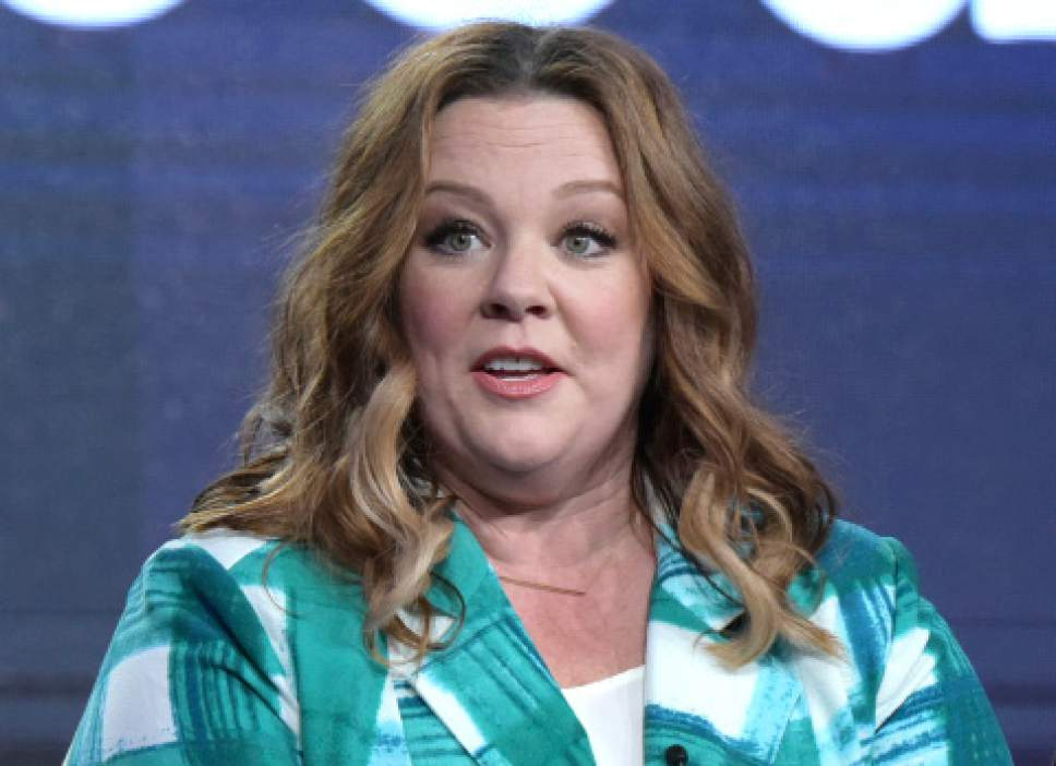"""FILE - In this Friday, Jan. 13, 2017, file photo, executive producer Melissa McCarthy speaks at the """"Nobodies"""" panel at Viacom's TV Land portion of the Winter Television Critics Association press tour, in Pasadena, Calif. McCarthy lampooned White House press secretary Sean Spicer in a """"Saturday Night Live"""" sketch on Saturday, Feb. 4, 2017, where she taunted reporters as """"losers,"""" fired a water gun at the press corps and even used the podium to bash a Wall Street Journal journalist. (Photo by Richard Shotwell/Invision/AP, File)"""