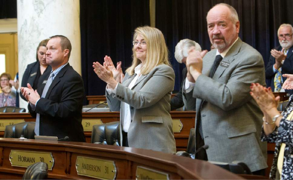 Rep. Wendy Horman, R-Idaho Falls, center, and her House colleagues applaud the end of the session, Wednesday, March 29, 2017, in Boise, Idaho. Both the Idaho House and Senate adjourned Wednesday. (Katherine Jones /Idaho Statesman via AP)