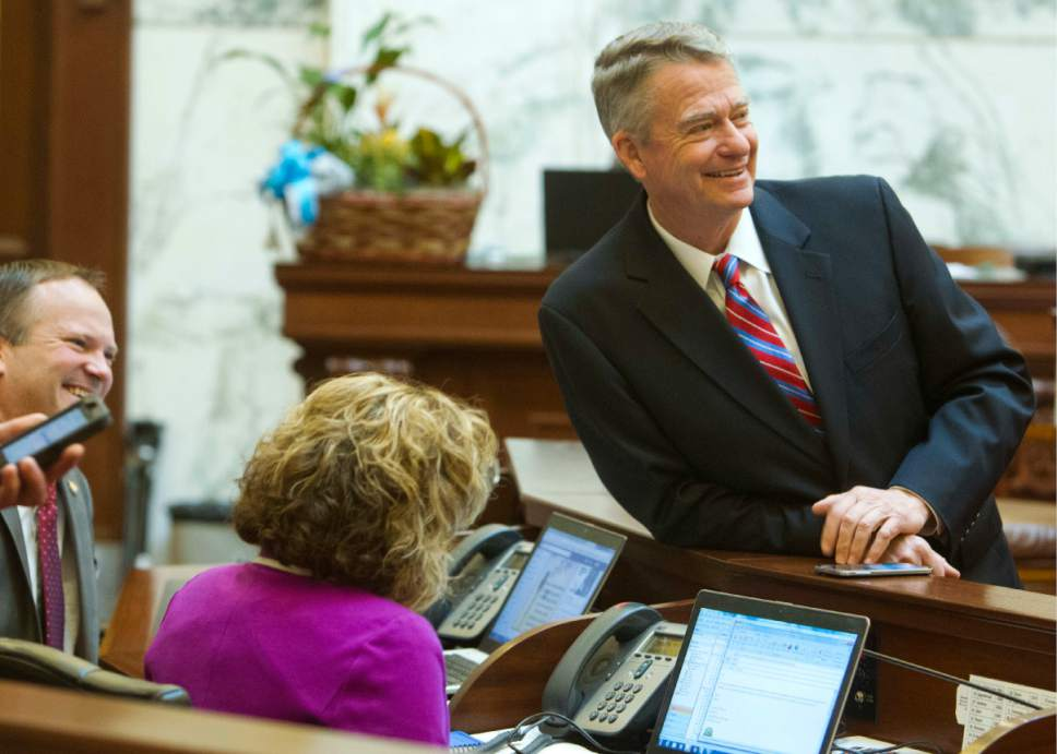 Lt. Gov. Brad Little socializes with senators as the Senate is at ease on Wednesday morning, March 29, 2017, finishing up the last of their work before adjournment in Boise, Idaho. Both the Idaho House and Senate adjourned Wednesday. (Katherine Jones /Idaho Statesman via AP)