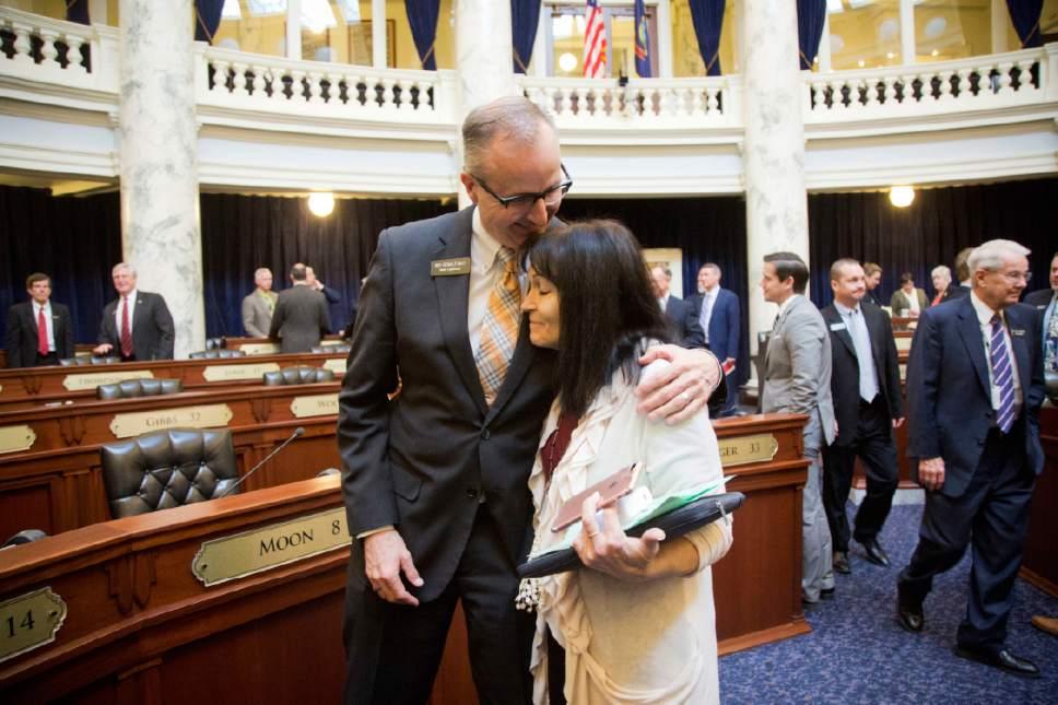 Reps. Ronald Nate, R-Rexburg, and Christy Zito, R-Hammett, say farewell after the House adjourned, Wednesday, March 29, 2017, in Boise, Idaho. Both the Idaho House and Senate adjourned on Wednesday. (Katherine Jones /Idaho Statesman via AP)