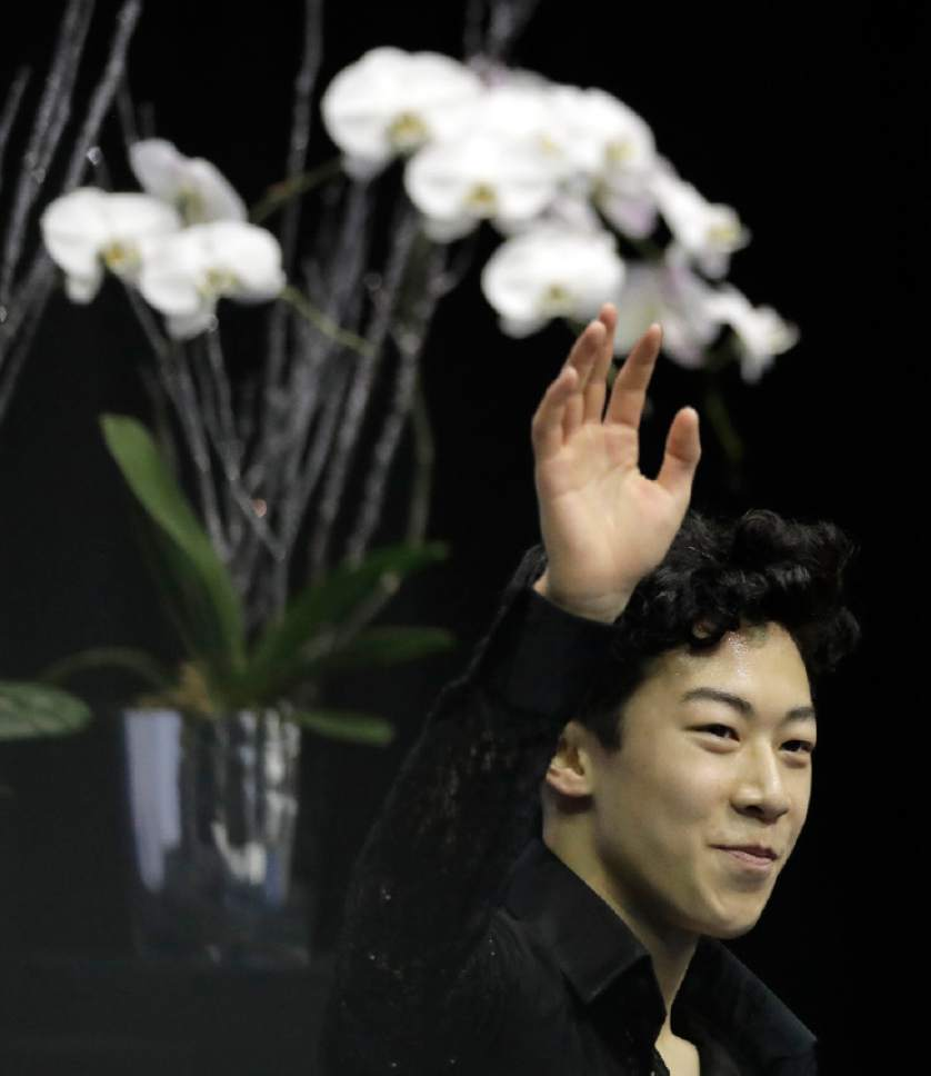 Nathan Chen waves to the crowd after his score was announced in the men's short program at the U.S. Figure Skating Championships on Friday, Jan. 20, 2017, in Kansas City, Mo. (AP Photo/Charlie Riedel)