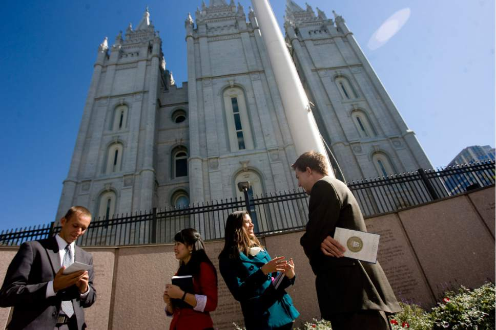 Kim Raff | The Salt Lake Tribune (middle left) Missionaries Sister Khanitta Puttapong and (middle right) Sister Christina Wong talk to (left) Casey Ahlstrom and (right) Jason Mondon in Temple Square during the 183rd General Conference of the LDS Church in Salt Lake City, Utah on Oct. 7, 2012. The day before, church President Thomas S. Monson had announced lower age limits for Mormon missionaries -- 18 (down from 19) for men and 19 (down from 21) for women.