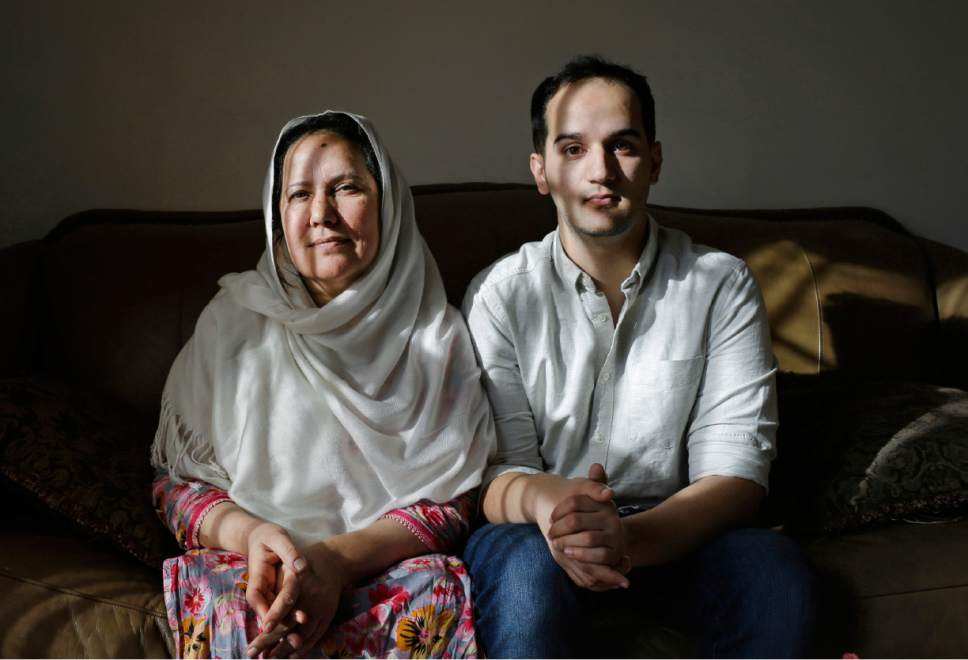 """FILE - In this Dec. 10, 2014 file photo, Shamim Syed, left, whose son Adnan was convicted for the 1999 murder of his ex-girlfriend  poses for a photograph alongside her son Yusef in her home  in Baltimore. Adam Syed, the subject of the popular podcast """"Serial"""" will be allowed to appeal his murder conviction, a Maryland court has ruled.  Syed, 34, was convicted in 2000 of strangling his ex-girlfriend, Hae Min Lee, the year prior, when both were high school students in suburban Baltimore. """"Serial"""" examined the case in detail and raised questions about Syed's guilt and whether he received a fair trial. (AP Photo/Patrick Semansky)"""