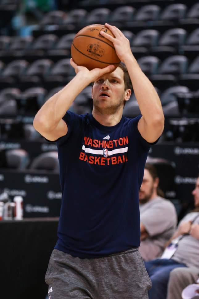 Washington Wizards guard Bojan Bogdanovic (44) shoots the ball before an NBA basketball game against the Utah Jazz, Friday, March 31, 2017, in Salt Lake City. (AP Photo/Chris Nicoll)