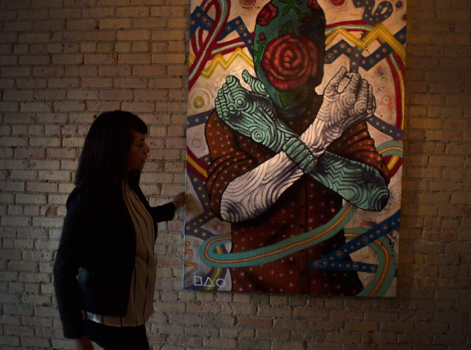 Leah Hogsten  |  The Salt Lake Tribune  Black Sheep owner Bleu Adams straightens the work of Navajo artist Jeff Slim. Black Sheep at Epic Brewing dishes up creative and flavorful  American Indian and Southwestern cuisine alongside Epic Brewing beers at this trendy, new Sugar House location once home to The Annex.