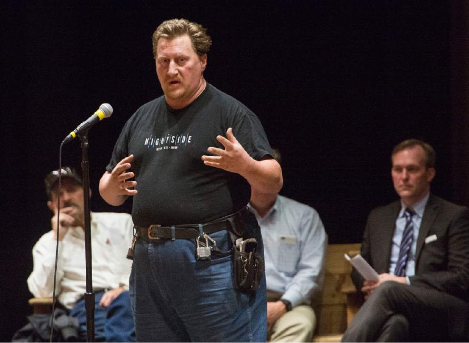 Rick Egan  |  The Salt Lake Tribune  Hecklers in the crown shout at Laurence Horman, who is homeless, as he tries to tell his story, during an open house for two new potential homeless shelter sites in the Draper area at the Draper Park Middle School auditorium, for, Wednesday, March 29, 2017.