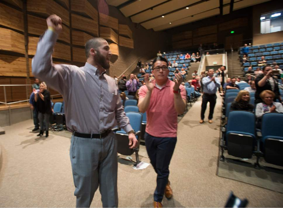 Rick Egan  |  The Salt Lake Tribune  Members of the audience cheer as  Draper Mayor Troy Walker announces that the deal is off, after more than three hours of public comment, on the two new potential homeless shelter sites in the Draper area, at the Draper Park Middle School auditorium, for, Wednesday, March 29, 2017.