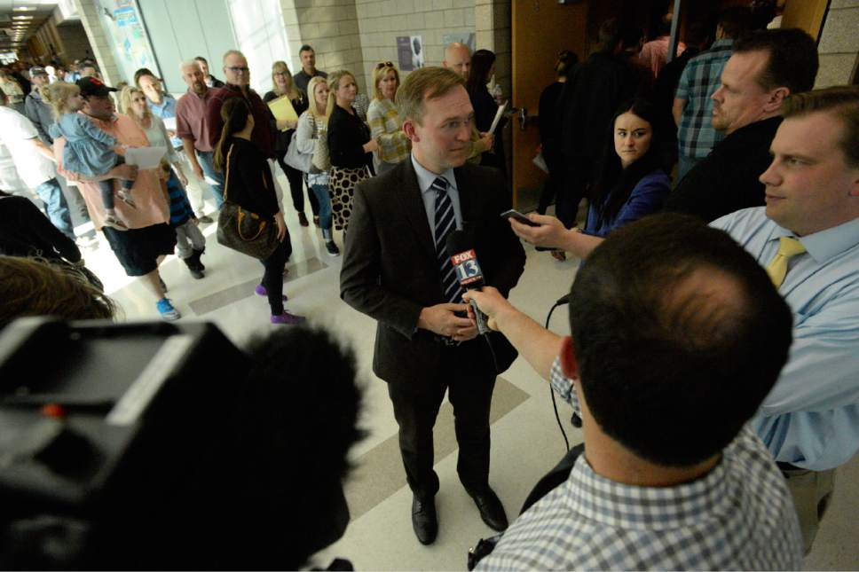 Rick Egan  |  The Salt Lake Tribune  Angry citizens heckle Salt lake County Mayor Ben McAdams as the enter the Draper Park Middle School auditorium, for an open house for two new potential homeless shelter sites in the Draper area, Wednesday, March 29, 2017.