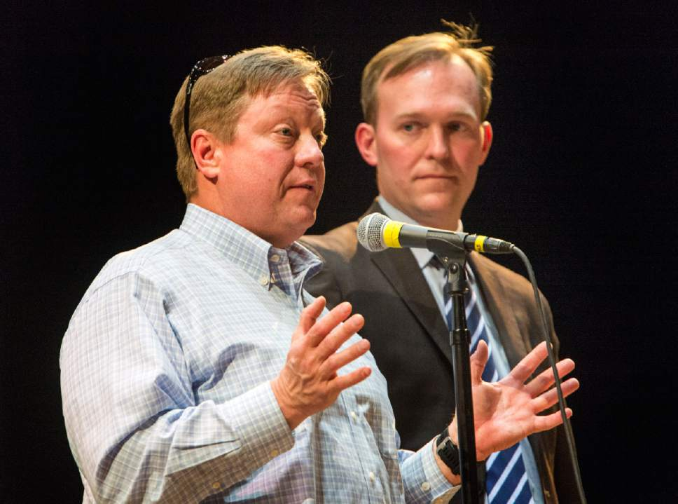 Rick Egan  |  The Salt Lake Tribune  Draper Mayor Troy Walker and Salt lake County Mayor Ben McAdams try to speak over boos and heckles from the angry  crowd during an open house to discuss two new potential homeless shelter sites in the Draper area, at the Draper Park Middle School auditorium, for, Wednesday, March 29, 2017.