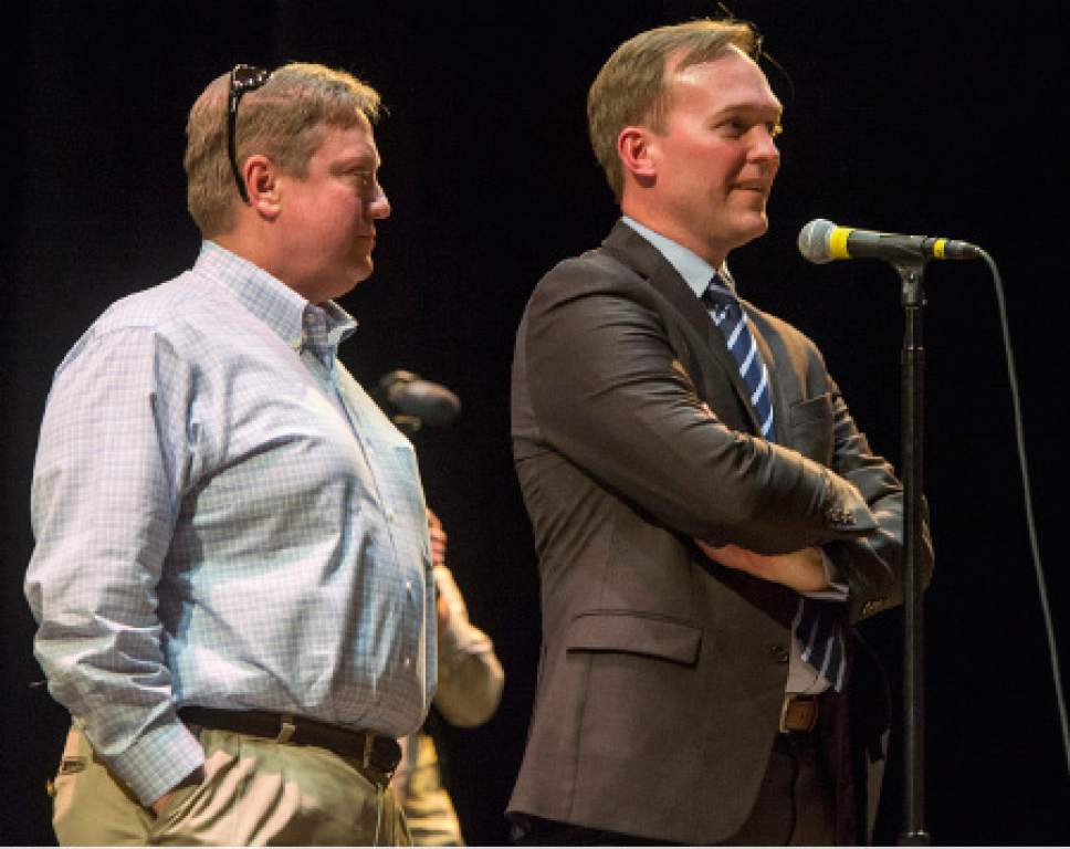 Rick Egan  |  The Salt Lake Tribune  Draper Mayor Troy Walker stands with Salt Lake County Mayor Ben McAdams, as they wait for crowd to calm down so they can explain the details, during an open house to discuss two new potential homeless shelter sites in the Draper area, at the Draper Park Middle School auditorium, for, Wednesday, March 29, 2017.