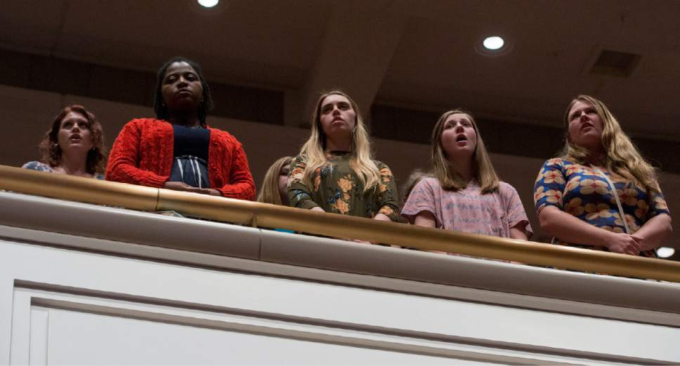 Rick Egan  |  The Salt Lake Tribune  LDS women stand and sing the intermediate hymn, at the Women's Conference session of LDS General Conference, at the LDS Conference center,  Saturday, March 25, 2017.