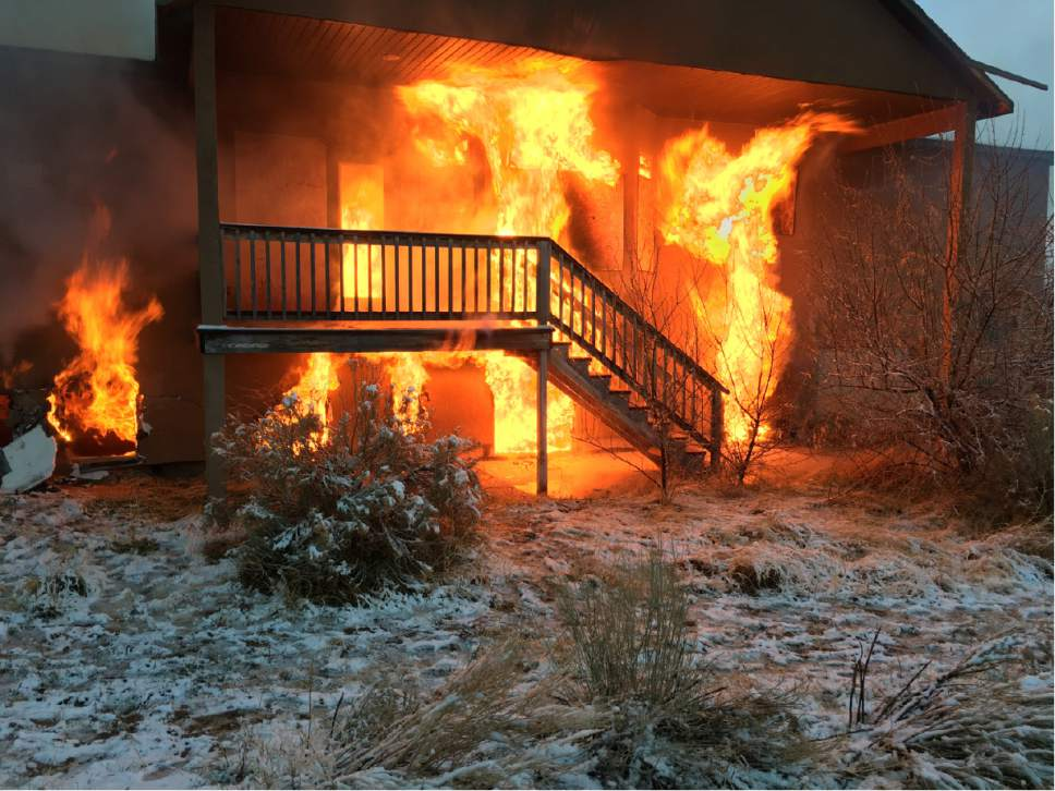 Courtesy of Cedar City Fire Department The sole existing home in Enoch City's Parkview subdivision was burned to the ground this week after it was deemed uninhabitable due to a ground fissure.