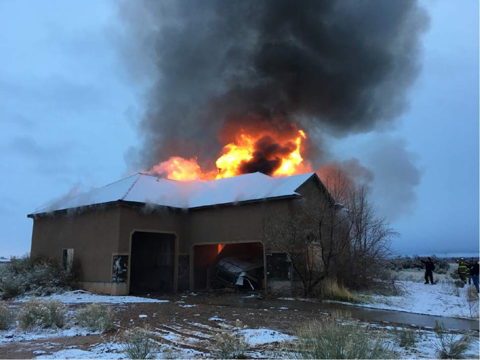 |  Courtesy of Cedar City Fire Department  The sole existing home in Enoch City's Parkview subdivision was burned to the ground this week after it was deemed uninhabitable due to a ground fissure.