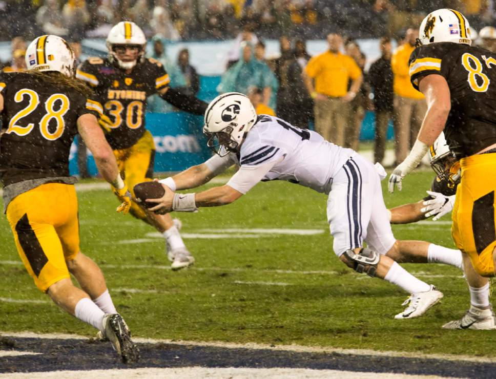 Rick Egan     The Salt Lake Tribune  Brigham Young Cougars Brigham Young Cougars quarterback Tanner Mangum (12) dives for a BYU touchdown, in the Poinsettia Bowl, at Qualcomm Stadium in San Diego, December 21, 2016.