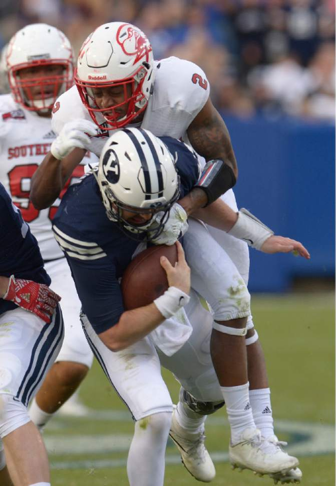 Leah Hogsten     The Salt Lake Tribune Brigham Young Cougars quarterback Tanner Mangum (12) on a first down run is taken down by Southern Utah Thunderbirds cornerback Josh Thornton (2). Brigham Young University defeated Southern Utah University 37-7 during their first match up at LaVell Edwards Stadium,  Saturday, November 12, 2016.
