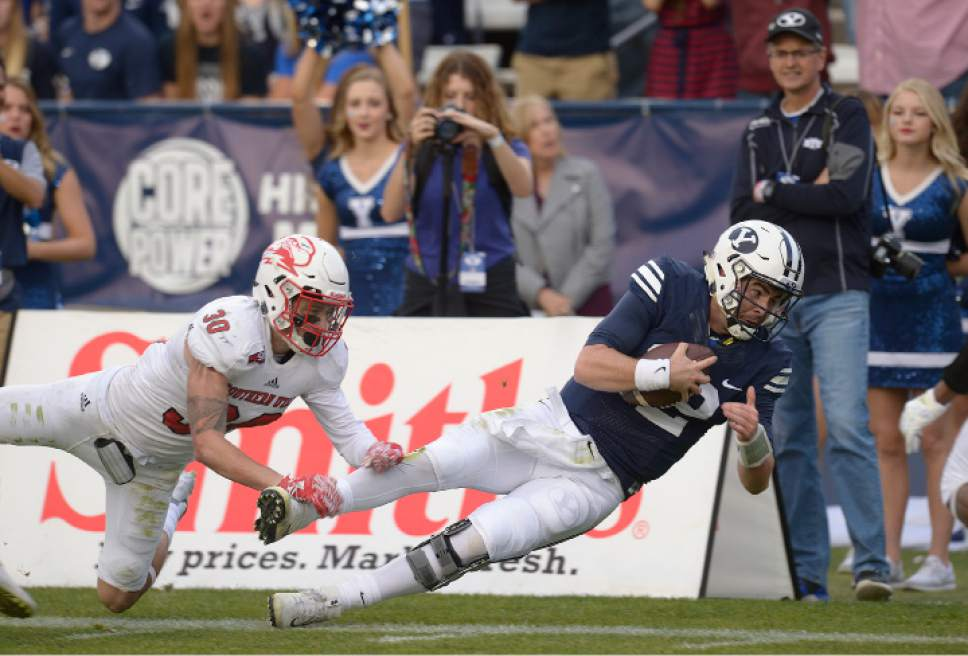 Leah Hogsten     The Salt Lake Tribune Brigham Young Cougars quarterback Tanner Mangum (12) tries to dive into the end zone but comes up short. Brigham Young University defeated Southern Utah University 37-7 during their first match up at LaVell Edwards Stadium,  Saturday, November 12, 2016.